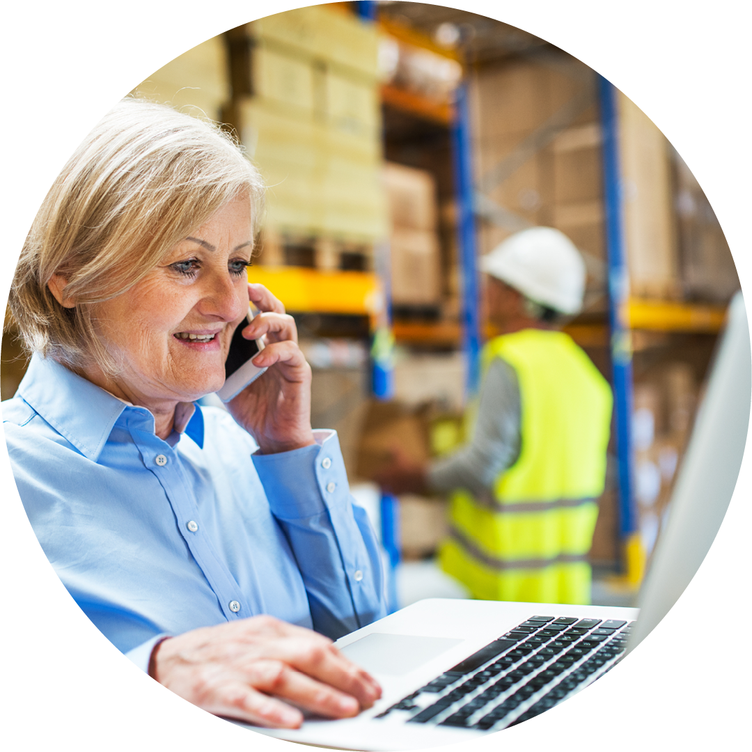 woman using laptop in warehouse